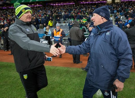 Jim Gavin shakes hands with Declan Bonner after the game