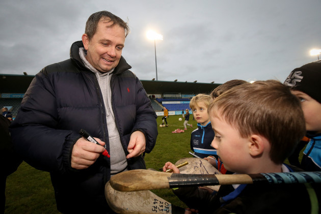 Davy Fitzgerald signs hurleys after the game