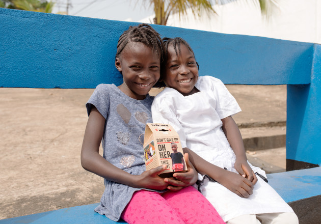 Kumba (7) is pictured with her younger sister Fatu (5) as they see their image on this year's Trócaire box for the first time.