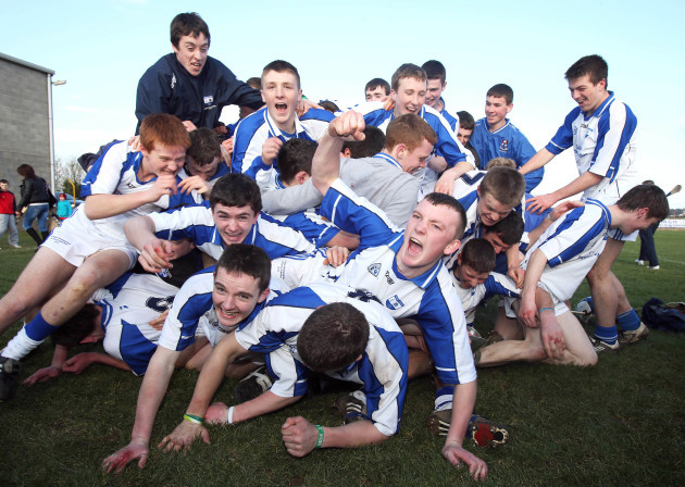 Dungarvan Colleges players celebrate with the cup