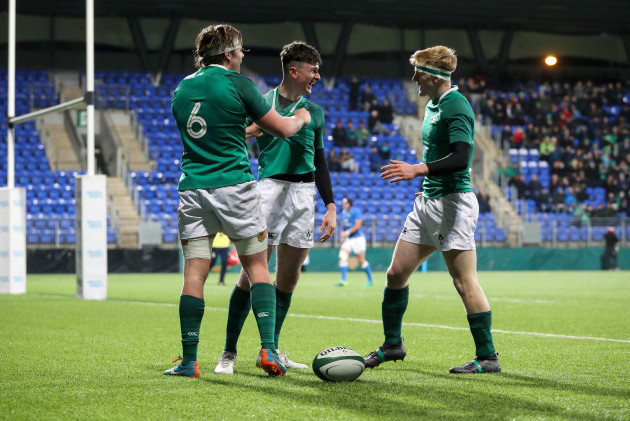 James McCarthy celebrates scoring his side's fourth try with Sean Masterson and Tommy O'Brien