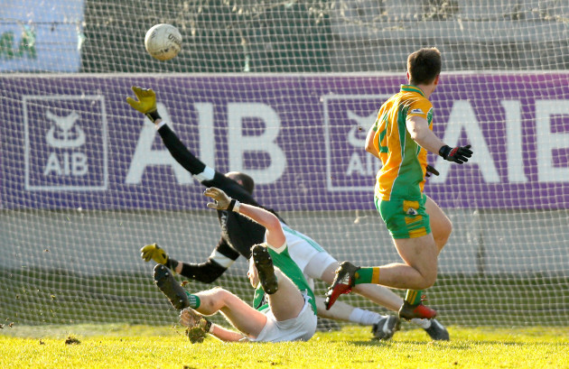 Liam Silke scores the winning goal despite Liam Callaghan and goaljeeper Tom Kinsella