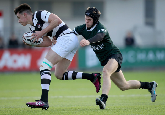 Jamie O'Grady is tackled by Con Creedon