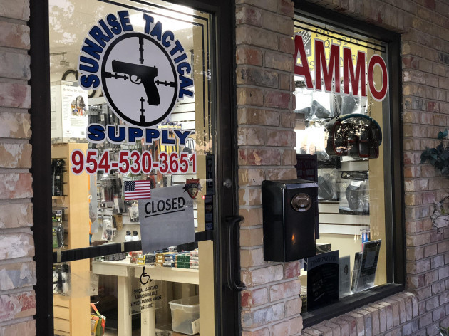 Gun shop owners distraught over selling rifle to 'maniac' who killed 17 at school