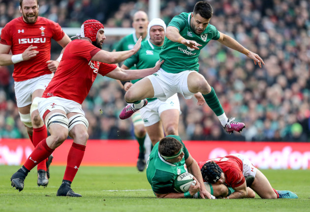 Conor Murray jumps CJ Stander as he's tackled by Leigh Halfpenny
