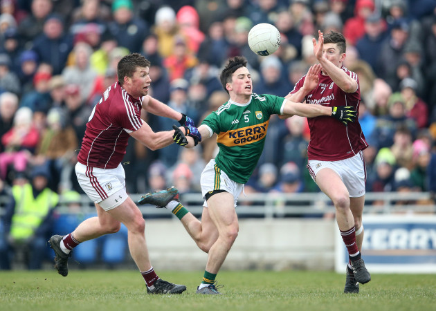 Paul Murphy under pressure from Gareth Bradshaw and Johnny Heaney