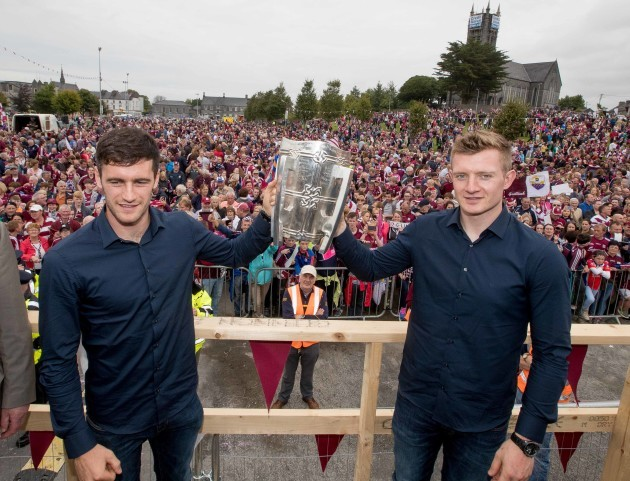 David Burke and Joe Canning show the Liam McCarthy Cup to the crowd in Ballinasloe