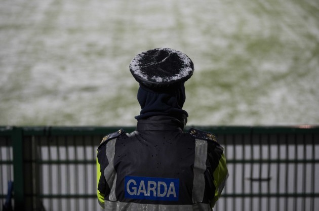 A Garda with a snow covered hat during the game