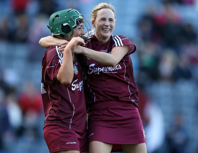 Heather Cooney and Therese Maher celebrate
