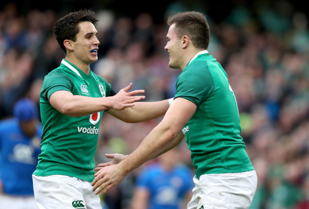 Jacob Stockdale celebrates scoring his sides seventh try with Joey Carbery