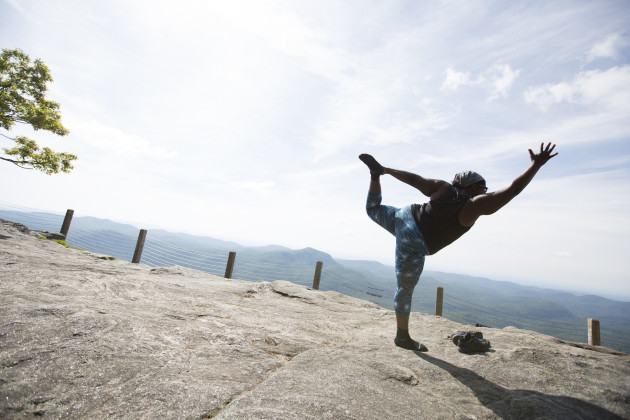 Mirna practicing yoga on the top of Whiteside Mountain, North Carolina.