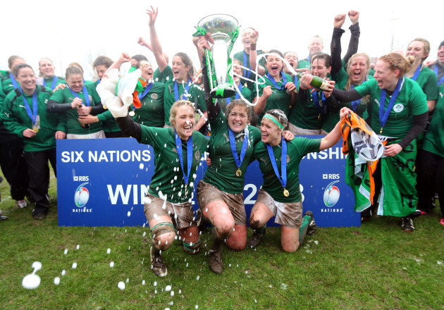 Joy Neville, Fiona Coghlan and Lynne Cantwell lift the cup