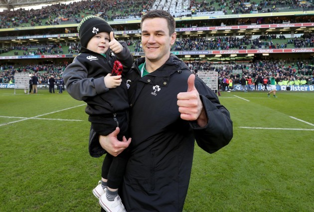 Jonathan Sexton celebrates winning with his son Luca