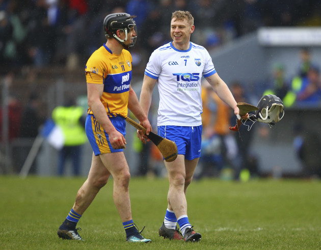 Waterford's Philip Mahony and Clare's John Conlon share a joke at the end of the game