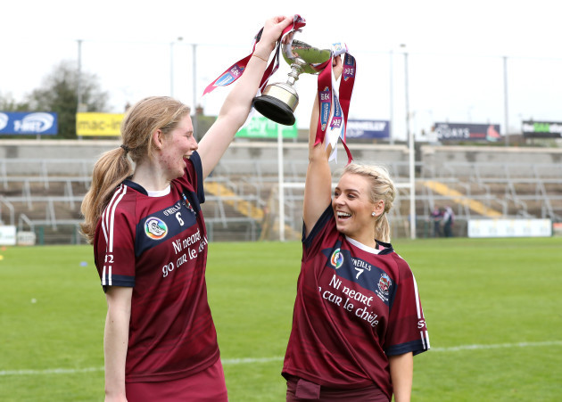 Aoife Ni Chaiside and Clare McGrath celebrate with the cup