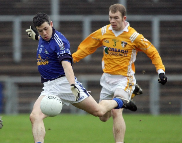 Sean McVeigh look on as Paddy Gumley scores a goal