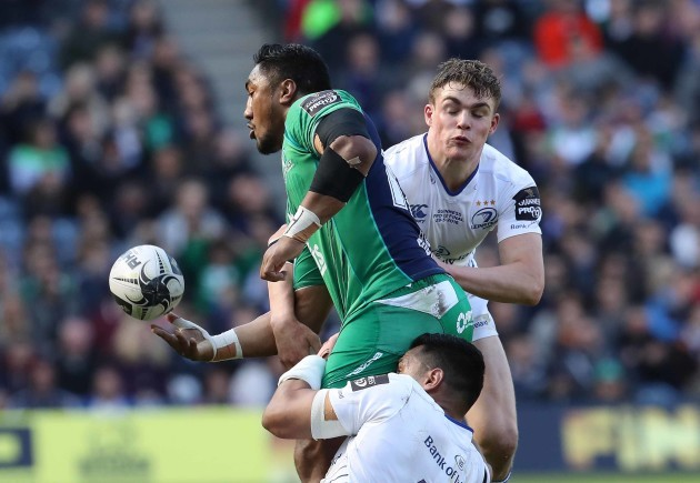 Connacht's Bundee Aki is tackled by Leinster's Ben Te'o and Garry Ringrose