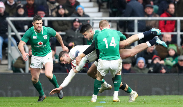Jonny May is tackled by Ireland's Keith Earls and Conor Murray