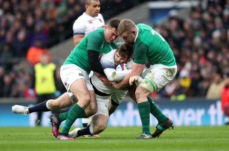 Jacob Stockdale and Dan Leavy tackle Elliot Daly