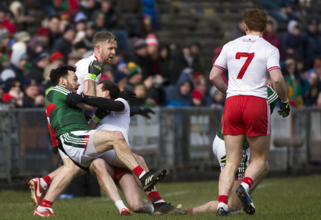Tom Parsons is pulled to the ground by Colm Kavanagh earning the Tyrone man a black card