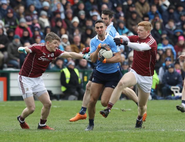 Sean Andy O'Ceallaigh and David Wynne tackle James McCarthy