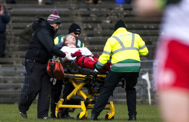 Hugh Pat Mcgeady leaves the field on a stretcher
