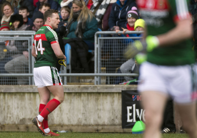 Andy Moran heads for the dressing room following a a black card