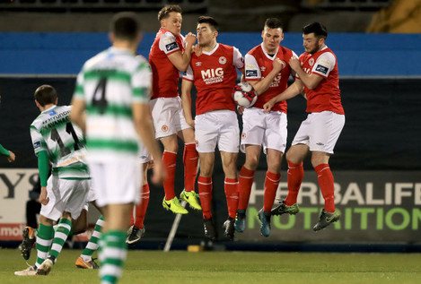 The St. Patrick's Athletic wall blocks a free kick from Sean Kavanagh