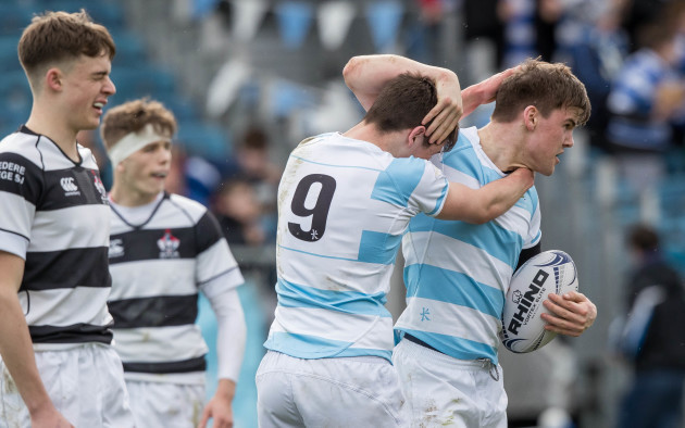 Liam McMahon is congratulated by team mate Louis O'Reilly after scoring a try