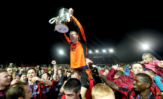 Paul Hunt celebrates with the First Division trophy