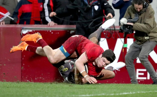 Alex Wootton scores a try despite the efforts from Tom Varndell