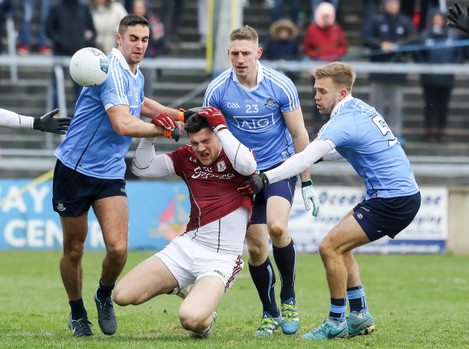 Damien Comer tackled by James McCarthy and John Cooper