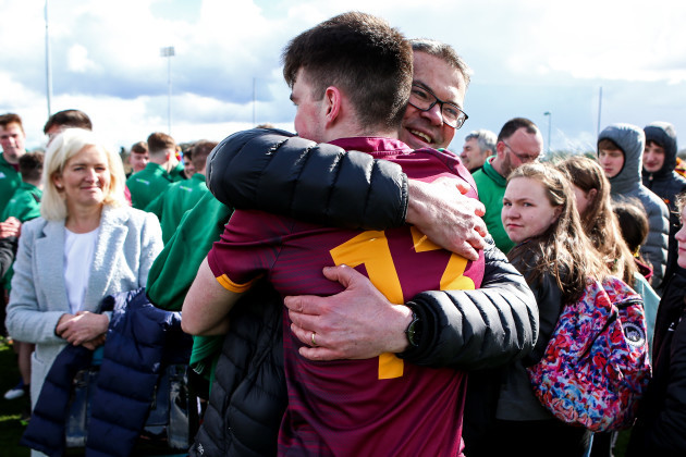 Ruairi McConville celebrates with his father