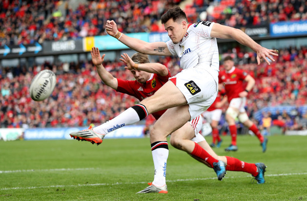 Jacob Stockdale clears the ball under pressure from Angus Lloyd