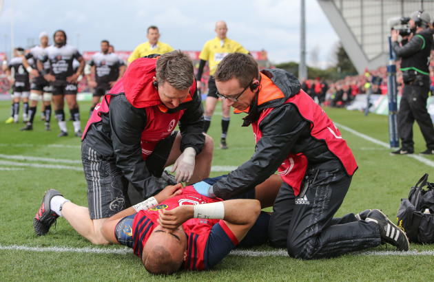 Simon Zebo receives treatment after a knock