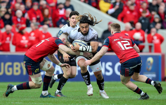 Ma'a Nonu tackled by Jack O'Donoghue and Rory Scannell