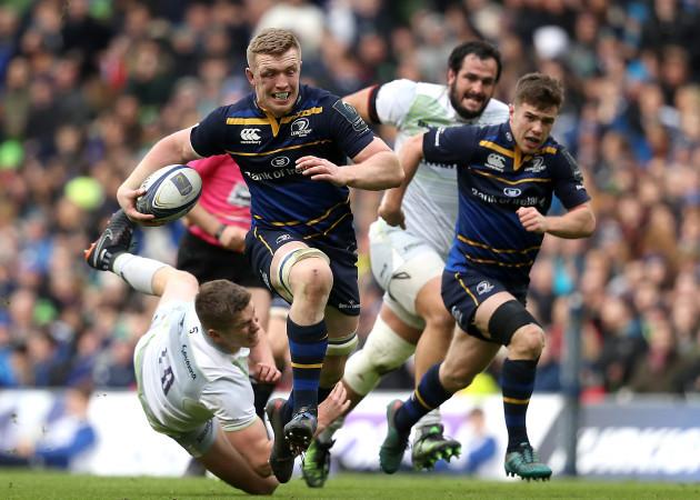 Dan Leavy runs in a try despite the efforts from Owen Farrell