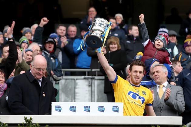 Conor Devaney lifts the league trophy