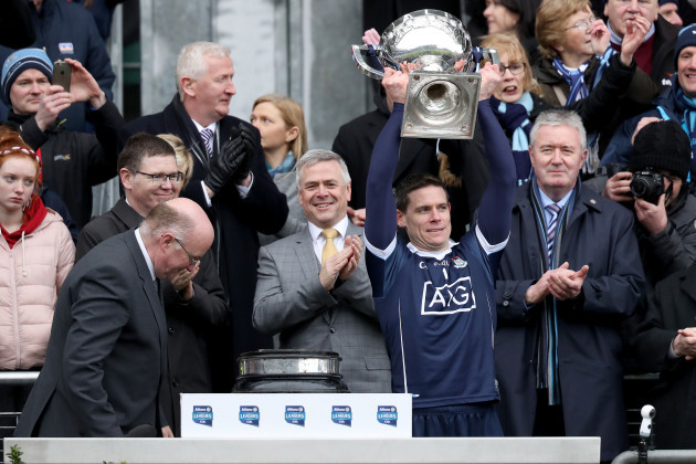 Stephen Cluxton receives the trophy from John Horan