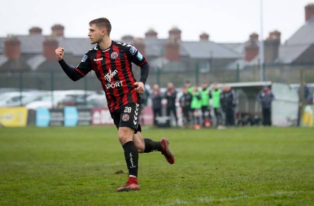 Eoghan Stokes celebrates scoring the winning penalty