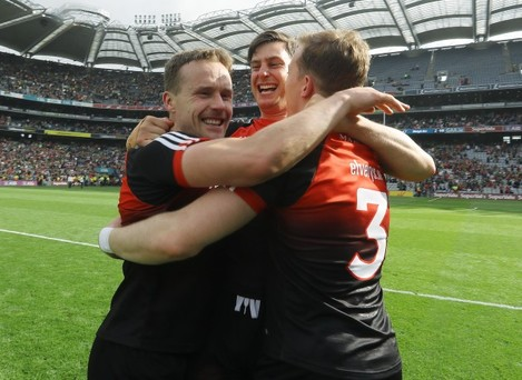 Andy Moran celebrates with Barry Moran and Donal Vaughan
