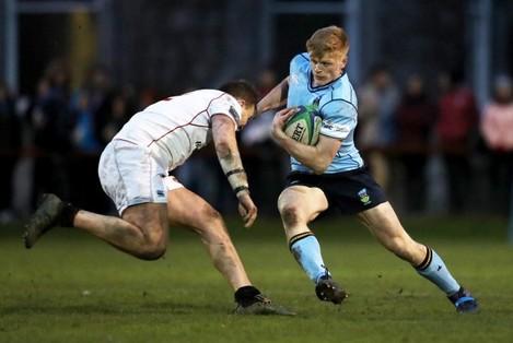 Tommy O'Brien is tackled by Kyle Dixon