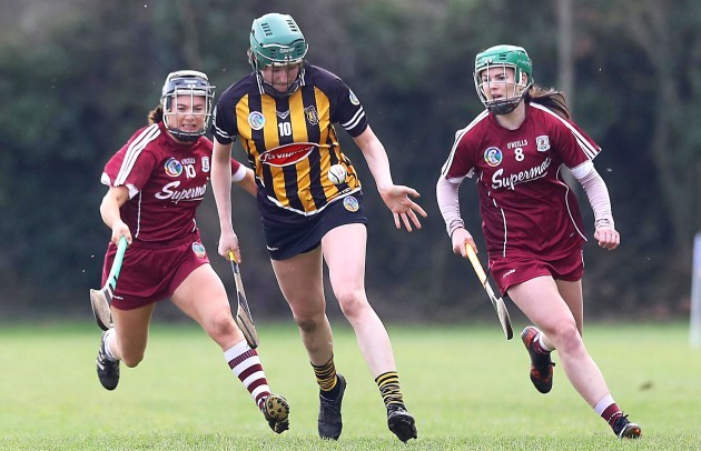 Denise Gaule tackled by Aoife Donohue and Anne Dalton