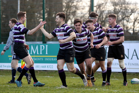 Sam Coughlan Murray celebrates his try with teammates