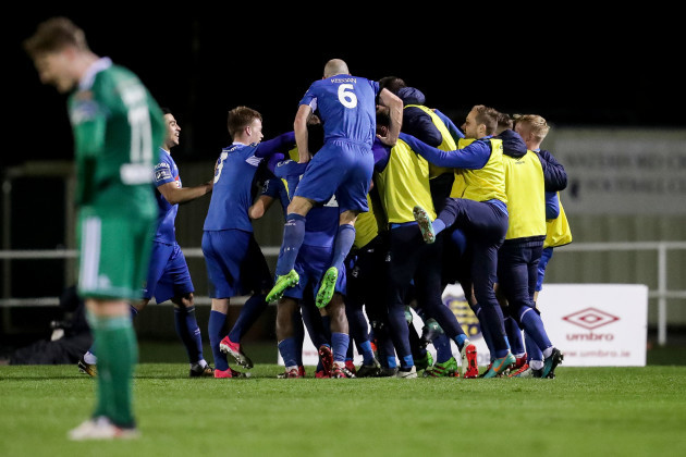 Waterford players celebrate after Izzy Akinade's goal