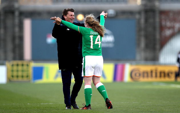 Amber Barrett celebrates with Colin Bell at the final whistle