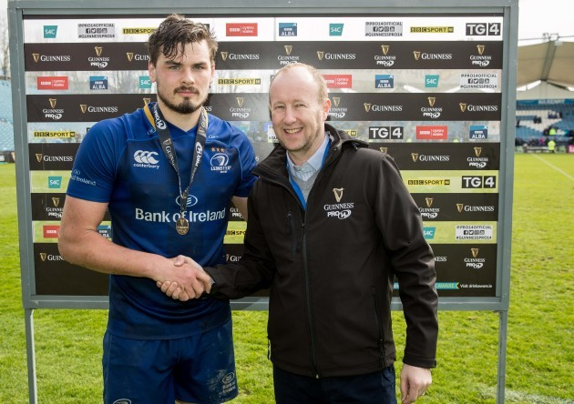 Max Deegan receives the Guinness Man of the Match medal from Rory Sheridan