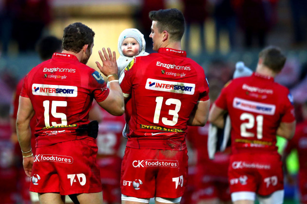 Leigh Halfpenny celebrates with Scott Williams and Scott's son Seb