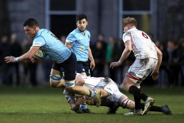 Stephen McVeigh is tackled by Jack Burke