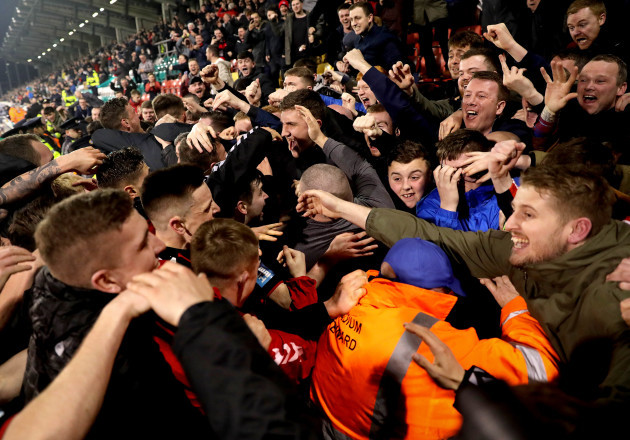Darragh Leahy celebrates scoring their second goal with fans and his teammates
